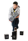 Young man with a speakers. Isolated Royalty Free Stock Images