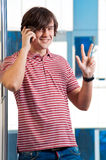 Young man speaking on cellphone Stock Image