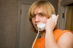 Young man speaking by phone. Royalty Free Stock Images