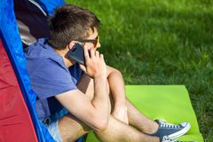 Young Man with a Phone stock photography