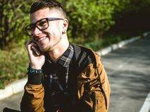Young man speaking by phone royalty free stock photos