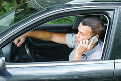 Young man speaking on telephone Stock Photos