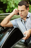 Young man speaking on telephone about car Royalty Free Stock Photos