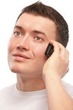 Young man speaks by mobile phone Royalty Free Stock Images