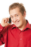 Young man speaks by a mobile phone Stock Photo