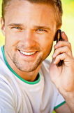 Young man speaks on phone Stock Image