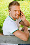 Young man speaks on phone Royalty Free Stock Photography