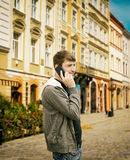 Young man speaks by phone Royalty Free Stock Photos