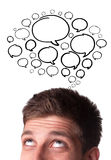 Young man with Speech Bubbles over his head Royalty Free Stock Photos