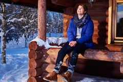 Young man spend winter holidays at mountain cottage Stock Images
