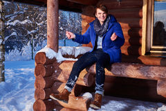 Young man spend winter holidays at mountain cottage Stock Photography