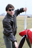 Young man spinning the airplane's propeller Stock Photo