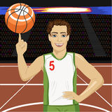 Young man spinning basketball ball with his finger on court in arena. Young man spinning basketball ball with his finger on court in the arena royalty free illustration