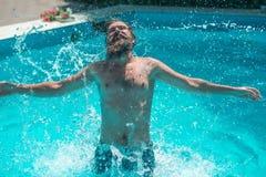 Young man splashing water Stock Image