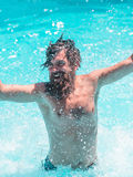 Young man splashing water Royalty Free Stock Image