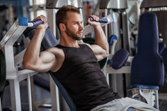 Young man in sport gym club Royalty Free Stock Photography
