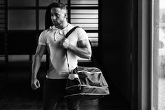 Young man with sports bag Stock Image