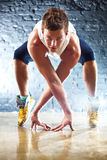 Young man sports exercises Stock Images