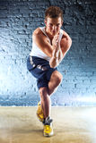 Young man sports exercises Stock Photo