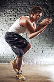 Young man sports exercises Royalty Free Stock Image
