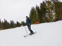 A young guy in sports glasses and skiing in the mountains in Pylypets, in Transcarpathia, Ukraine. A young man in sports glasses and skiing in the mountains in stock photography