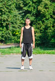 Young man in sports wear in park Royalty Free Stock Photography