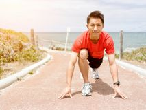 Young man getting ready for a run Stock Images