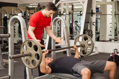 Young man spotting each other in a gym Royalty Free Stock Photography