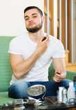 Young man spraying fragrance perfume Stock Photography