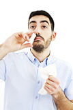 Young man spraying nose drops Stock Photography