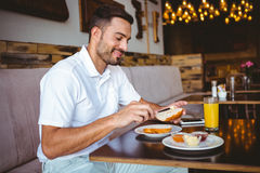 Young man spreading butter on a toast Royalty Free Stock Photography