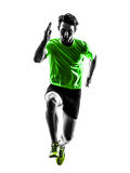 Young man sprinter runner running silhouette. One caucasian man young sprinter runner running in silhouette studio on white background Stock Image