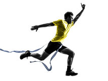 Young man sprinter runner running winner finish line silhouette. One caucasian man young sprinter runner running winner at finish line in silhouette studio on stock image