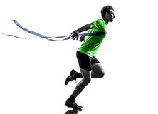 Young man sprinter runner running winner finish line silhouette. One man young sprinter runner running winner at finish line in silhouette studio on white royalty free stock photo