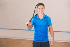 Young man squash player exercise game in the gym Stock Photos