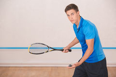 Young man squash player exercise game in the gym Royalty Free Stock Photography