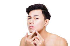 Young man Squeezing pimple. Handsome young man Squeezing pimple stock images