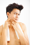 young man Squeezing pimple stock images