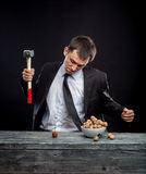Young man stabs a nut Stock Photography