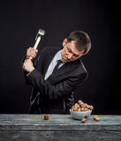 Young man stabs a nut Stock Images