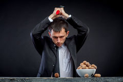 Young man stabs a nut Stock Photo