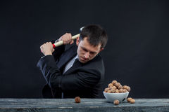 Young man stabs a nut Royalty Free Stock Images