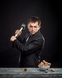 Young man stabs a nut Stock Image