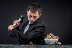 Young man stabs a nut Stock Photos