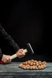 Young man stabs a nut Royalty Free Stock Photography