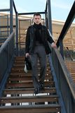 Young man on staircase Stock Photography