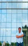 Young man stand in front of modern business building Stock Photos