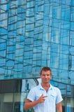 Young man stand in front of modern business building Royalty Free Stock Image
