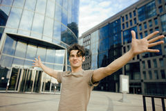 Young man stand in front of modern business building Stock Photography