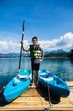 Young man stand with Kayak Stock Photos